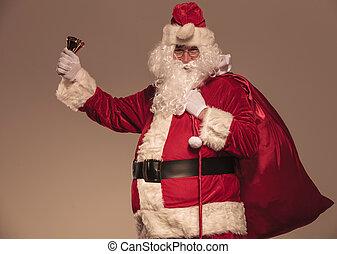 Santa Claus holding a his big bag on his shoulder