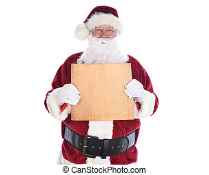 Santa Claus holding a piece old yellowed parchment paper in fornt of his torso, isolated on white. Blank paper with copy space.