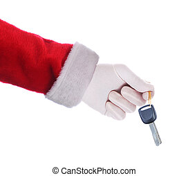 Santa Claus holding a set of car keys over a white background.