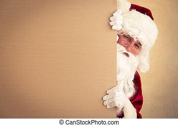 Santa Claus holding banner