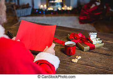 Santa Claus holding blank red paper