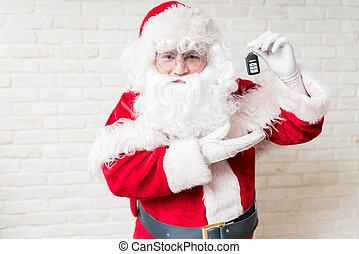Santa Claus holding car key at home