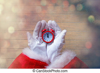 Santa Claus holding Chrstmas alarm clock