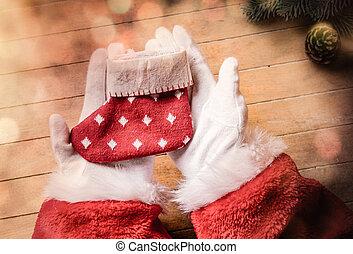 Santa Claus holding Chrstmas sock