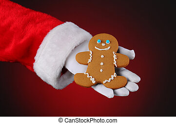 Santa Claus Holding Gingerbread Man in His Hand