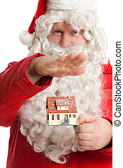 Santa Claus holding house