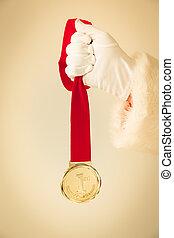 Santa Claus holding medal