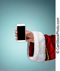 Santa Claus holding mobile smartphone ready for Christmas time