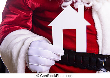 Santa Claus holding paper house
