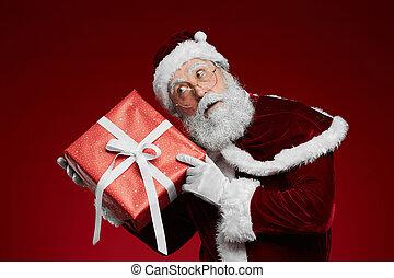 Santa Claus Holding Present
