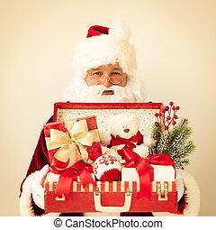 Santa Claus holding suitcase