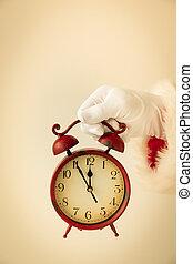 Santa Claus holding vintage alarm clock