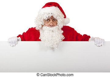 Santa Claus holds a white board blank for special Christmas offers and looks surprised. Isolated on white.