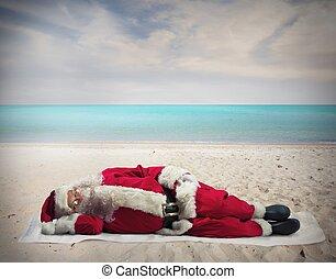 Santa Claus holiday - Santa Claus sleeping at the hot beach