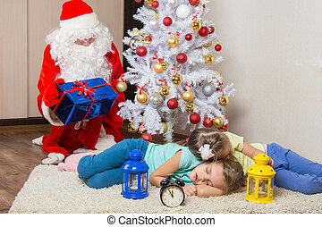 Santa Claus in New Years Eve gifts lays out and looked at...