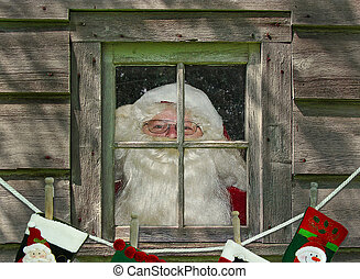 Santa Claus in window - Santa in window with holiday...