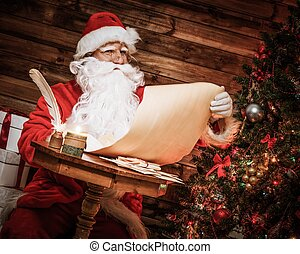 Santa Claus in wooden home interior reading wish list scroll