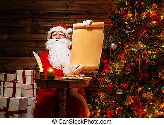 Santa Claus in wooden home interior holding blank wish list...