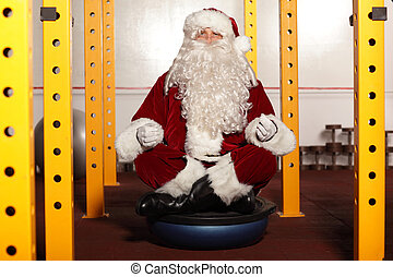 Santa Claus  in yoga position