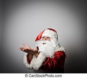 Santa Claus is blowing invisible snow