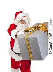 Santa Claus is handing over a big silver Christmas gift box. Isolated on white.
