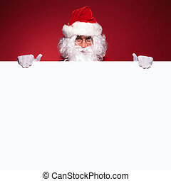 santa claus is holding a blank board