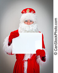 Santa Claus is holding white blank.