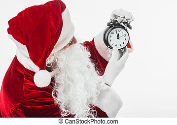 santa claus looking at clock in hands . High quality and resolution beautiful photo concept