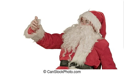 Santa Claus make selfie, holding a big present on white background