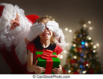Santa Claus making a surprise for little girl