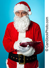 Santa Claus making his list of the good children