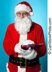 Santa Claus making his list of the good children