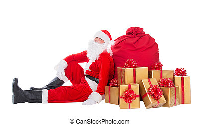 Santa Claus near big red Christmas sack full of gift boxes