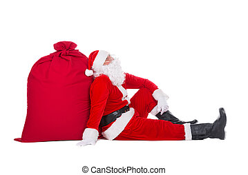 Santa Claus near big red Christmas sack full of presents and gifts