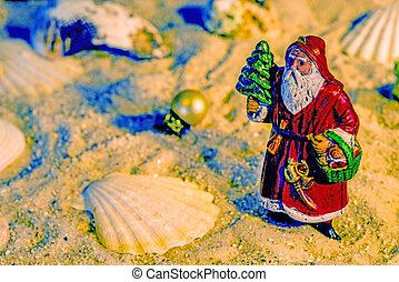 Santa Claus on a beach