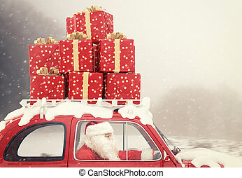 Santa Claus on a red car full of Christmas present - Santa...