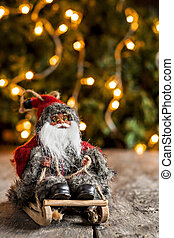 Santa Claus on a sledge on the background of Christmas lights