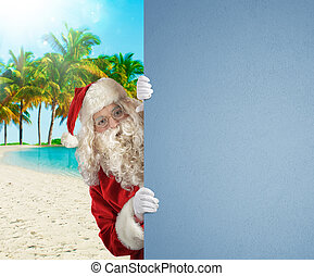 Santa Claus on a tropical beach with a blank space for your text