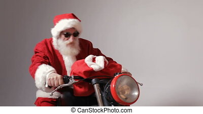 Santa Claus on Bike - Excited santa claus with red bag full...