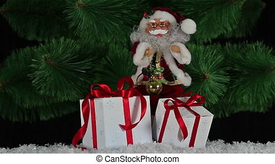 Santa Claus on snow with gift boxes