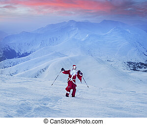 Santa Claus for New Year in a red suit with a bag of gifts at sunrise on the Montenegrin ridge at the top of Hoverla - the highest peak of Ukraine, 2061 meters