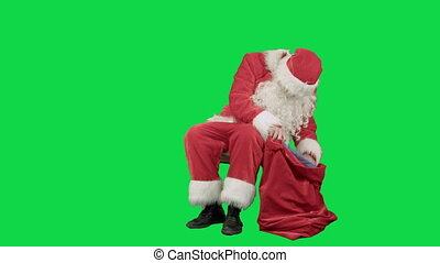 Santa Claus on the tablet in the New Year on a Green Screen Chrome Key