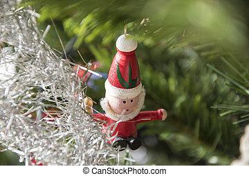 santa claus ornament hanging on christmas tree. Beautiful close up holiday photo.
