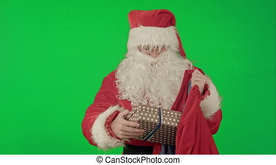 Santa Claus Packaging Gifts on a Green Screen Chrome Key