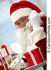 Santa Claus phoning