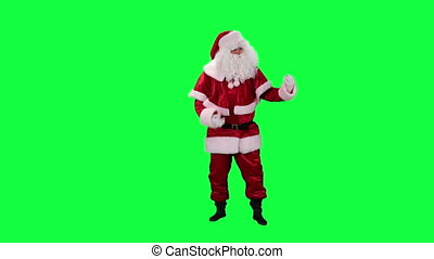 Santa Claus plays air guitar
