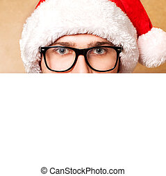 Santa Claus pointing in white blank sign with smile, isolated on