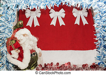 Santa Claus posing with bag of gifts on Christmas background