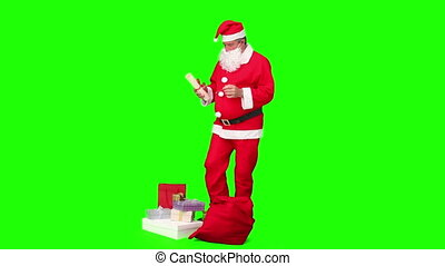 Santa Claus preparing himself against a green screen