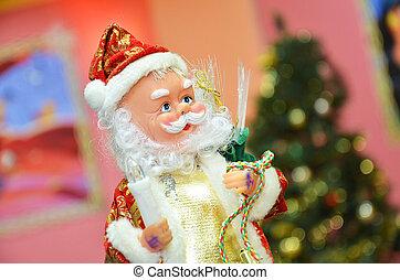 Santa claus puppet Christmas toy Santa Claus sits on a fir branch